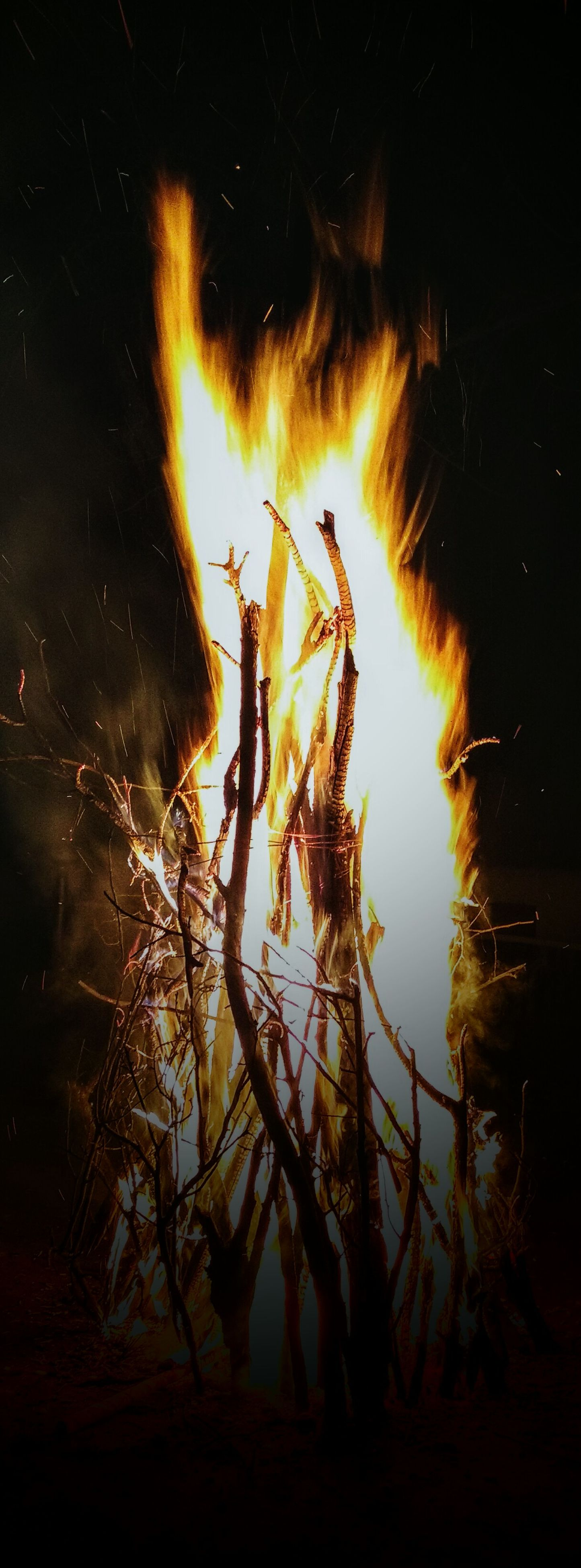 night, burning, fire - natural phenomenon, flame, silhouette, glowing, dark, heat - temperature, low angle view, outdoors, fire, illuminated, nature, tranquility, tree, bonfire, light - natural phenomenon, no people, sky, wood - material