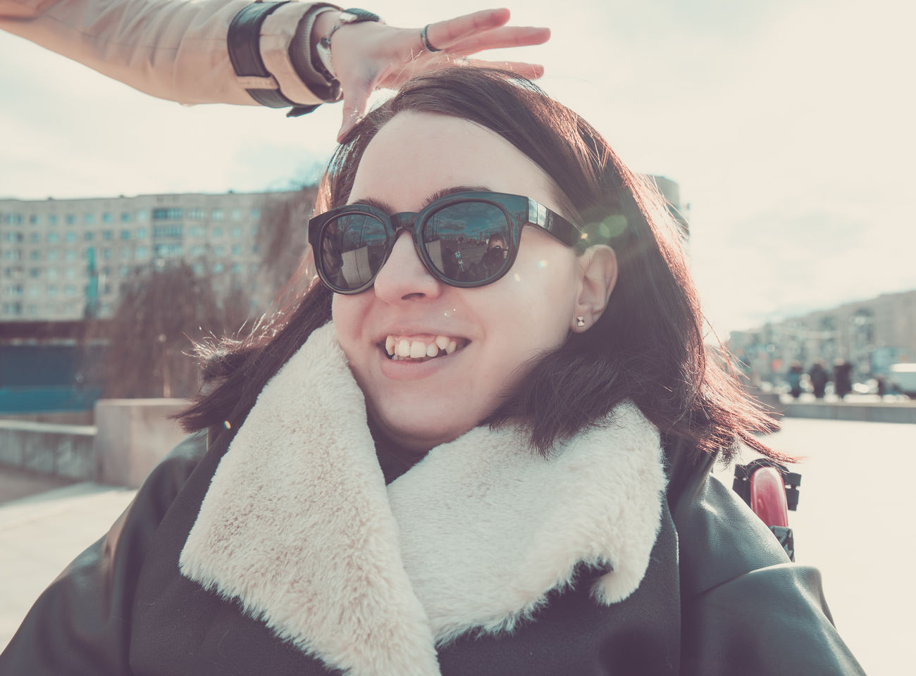 Beautiful Woman City Day Focus On Foreground Fur Fur Coat Headshot Leisure Activity Lifestyles Outdoors Portrait Real People Sky Smiling Sunglasses Two People Warm Clothing Young Adult Young Women