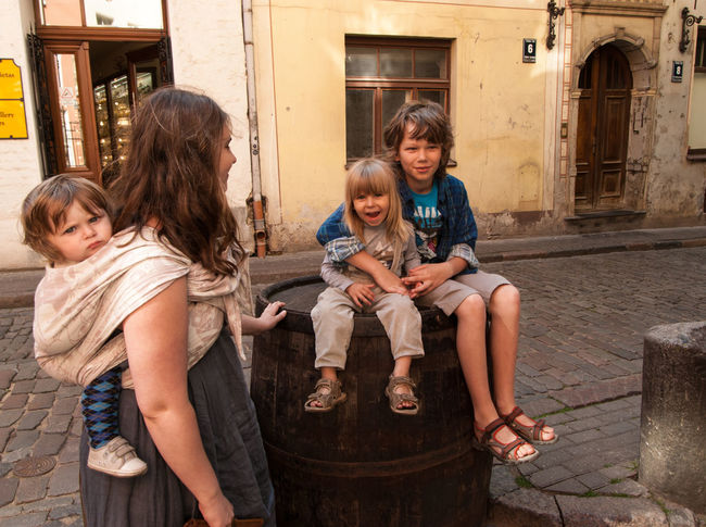 Sittin' on the barrel in the Old Town of Riga Baby Baby Sling Baby Wrap Babywearing Bonding Childhood Children Family Friendship Happiness Leisure Activity Lifestyle Looking At Camera Love Maternity Mom Mother And Son Motherhood Old Town Outdoors Parenting Riga Sling Smiling Woman