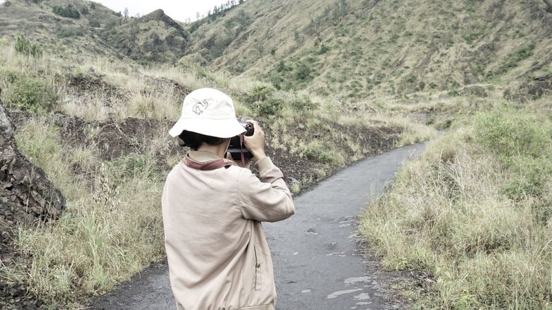 behind the lens Casual Clothing One Person Photography Themes Adventure Beauty In Nature Non-urban Scene Mountain Scenics Bali Camera - Photographic Equipment Men Lifestyles Outdoors Leisure Activity Photographer Day Standing Nature Young Adult Tree Landscape Technology Headwear People Adult The Great Outdoors - 2017 EyeEm Awards