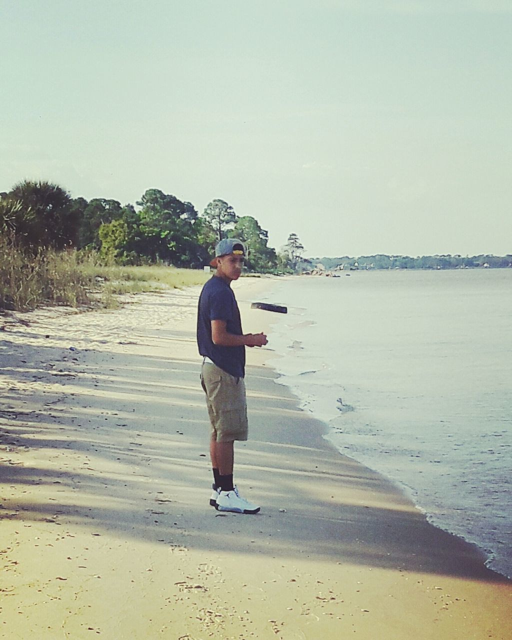 full length, one person, real people, beach, leisure activity, standing, lifestyles, senior adult, senior men, nature, day, outdoors, sea, sand, clear sky, water, men, beauty in nature, sky, adult, people, adults only