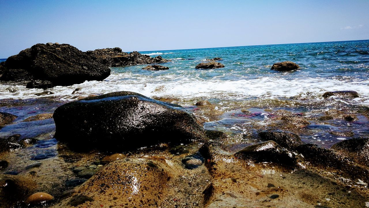 sea, rock - object, nature, water, beauty in nature, beach, no people, scenics, day, tranquility, horizon over water, outdoors, clear sky, sky