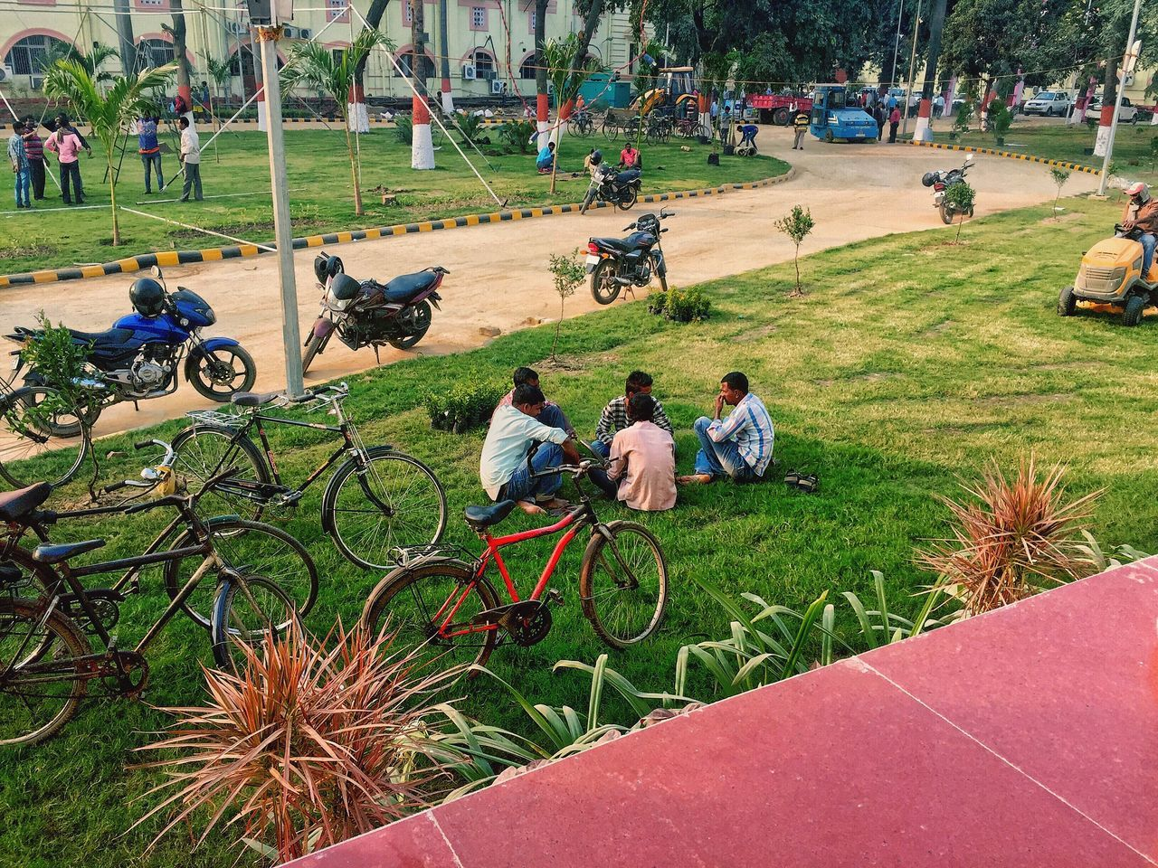 When It's expected to be a Very Busy Day,Few still finds time to Sit & chat around! Bicycle Real People Leisure Activity Grass Outdoors Day People Land Vehicle Mode Of Transport My Unique Style My View Iphone 6 Connection Special👌shot Leisure My Year My View