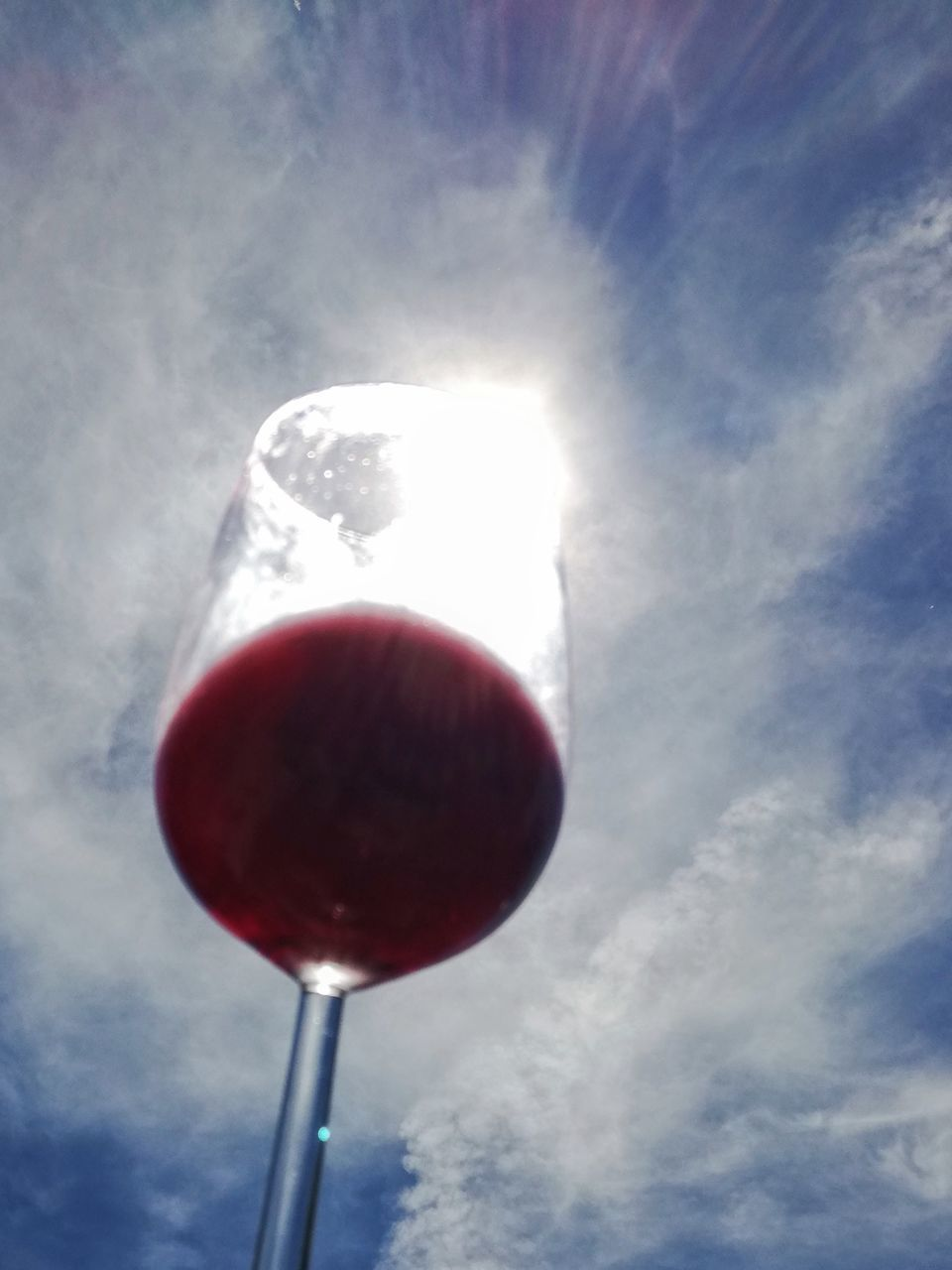 red, sunbeam, sky, low angle view, sun, outdoors, food and drink, no people, day, sunlight, freshness, close-up