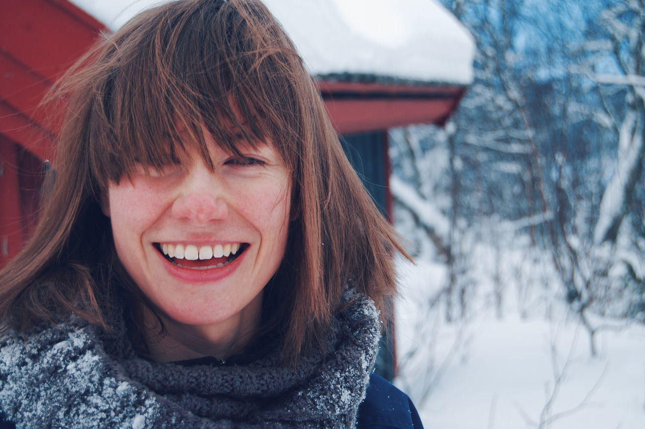 winter, snow, cold temperature, smiling, happiness, portrait, warm clothing, looking at camera, outdoors, toothy smile, one person, fun, cheerful, day, real people, leisure activity, nature, headshot, close-up, young adult, young women, people