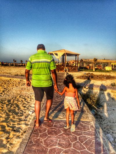 Two People Real People Beach Clear Sky Sand Childhood Day Sky People Egypt Vacations Thisisegypt Liveloveegypt Summer Summertime Summer ☀ Northcoast Grandpa Grandfather Granddaughter Traveling Home For The Holidays EyeEmNewHere The Street Photographer The Street Photographer - 2017 EyeEm Awards The Portraitist - 2017 EyeEm Awards