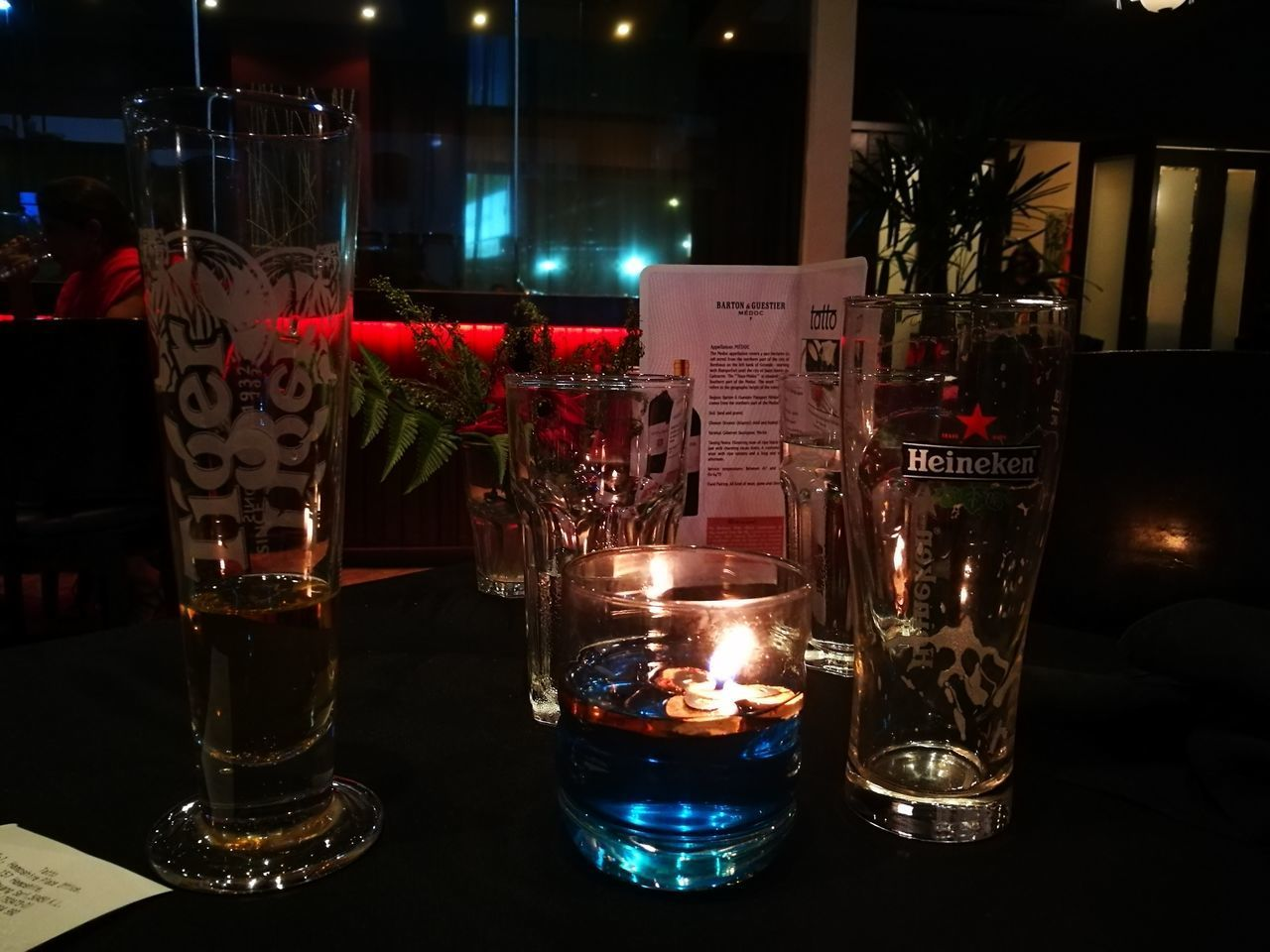 table, alcohol, drink, refreshment, illuminated, drinking glass, candle, night, beer, food and drink, indoors, no people, flame, freshness, close-up