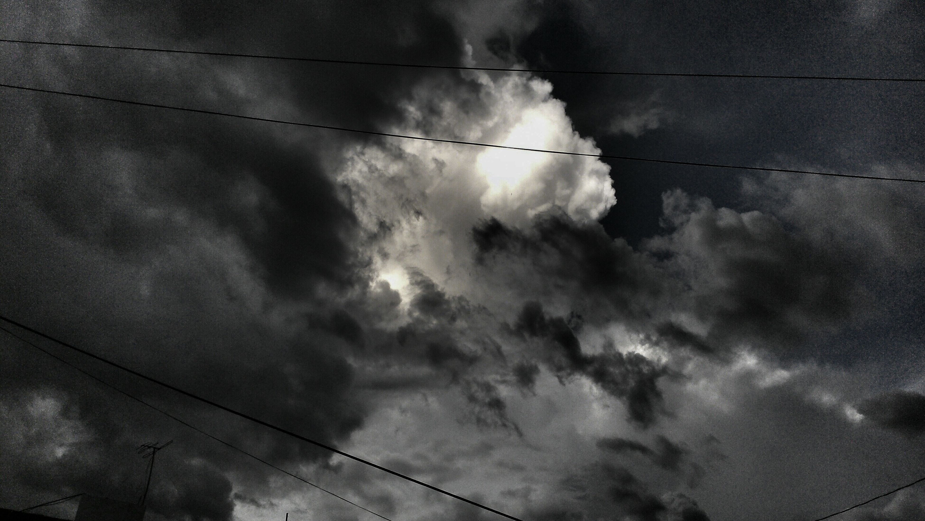 power line, sky, low angle view, cloud - sky, cable, cloudy, electricity, power supply, electricity pylon, cloud, connection, nature, weather, fuel and power generation, power cable, outdoors, overcast, no people, technology, tranquility