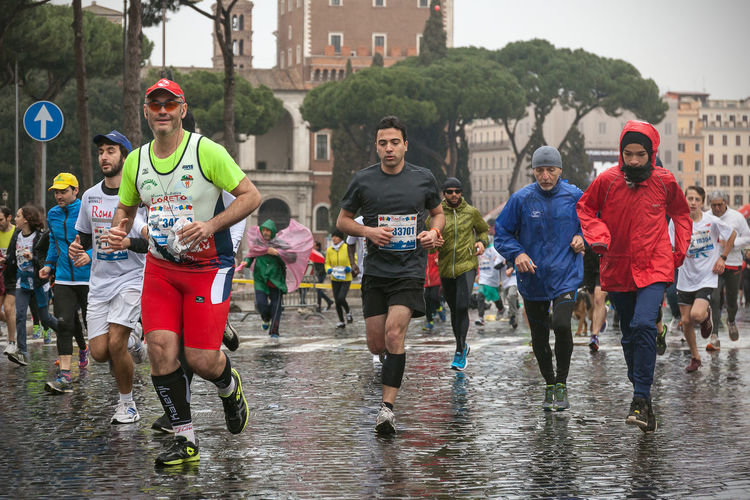 Rome, Italy - March 22, 2015: some athletes to twenty Rome Marathon run under a heavy rain that will accompany them throughout the race. Athlete Atletic Competition Day Italy Marathon Outdoors Rain Rome Runners Running Street Running Water