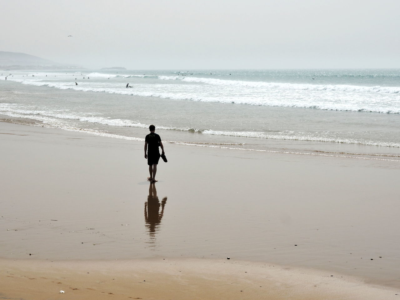 Beach Sea One Person Sand Only Men Wave Real People Beauty In Nature Men Water Nature One Man Only Full Length Day Outdoors Tranquility Scenics People Adult Horizon Over Water Taghazout Reflection Reflection_collection Morocco 🇲🇦 Morocco