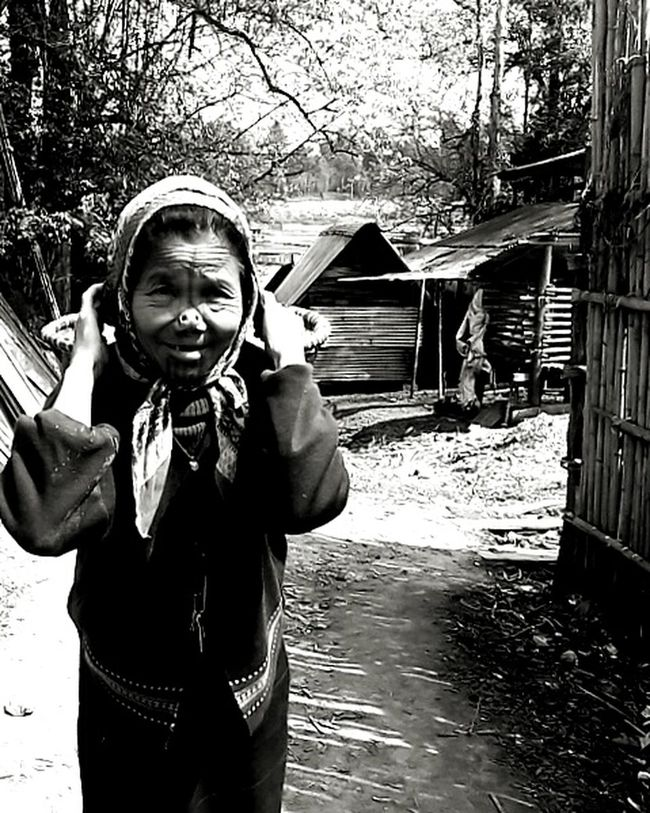 Old lady Cheese! Ziro valley/Arunachal Pradesh/India Lady Of The Woods Lady In Black And White Trees Background With Smile On Her Face
