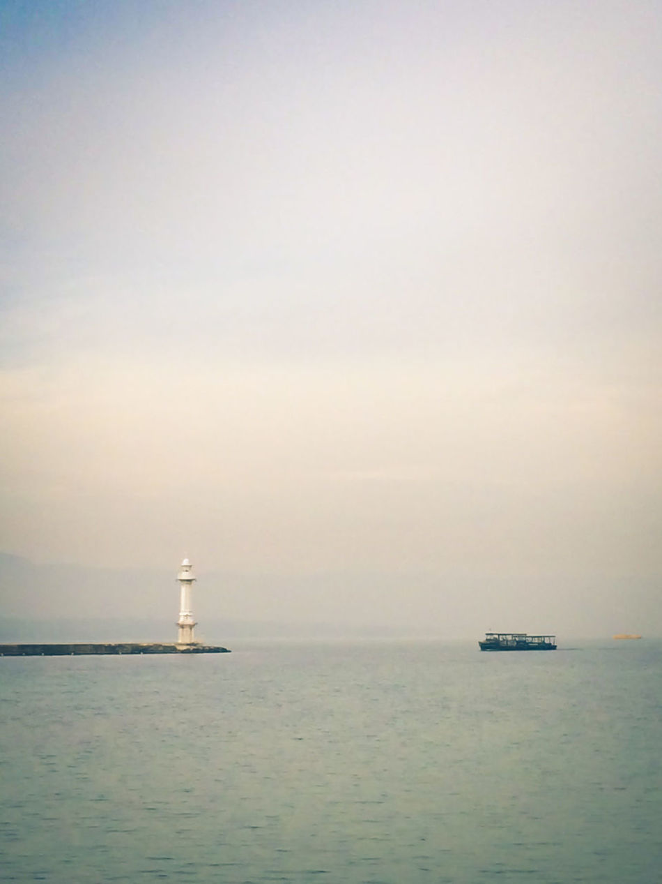 Beauty In Nature Boat Day Horizon Over Water Lighthouse Lighthouse Nature Nautical Equipment Nautical Vessel No People Outdoors Sailing Sea Sky Transportation Travel Destinations Water