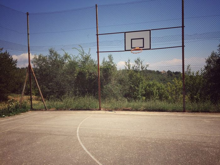 Old basketball court Playing Ground Court Basketball Hoop Tree Sport Day No People Outdoors Sky Playing Field Leisure Games Soccer Field first eyeem photo