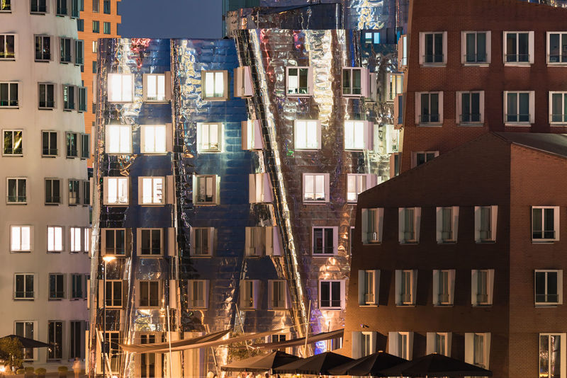 DUESSELDORF, GERMANY - SEPTEMBER 14, 2016: Modern facades in the media harbor reflect the sunset. Architecture Architecture Attraction Building Exterior Built Structure City Cityscape Düsseldorf Germany M Medienhafen New Media Harbor Night No People Outdoors People Place To Be  Scenics Ship Skyscraper Tourism Urban Urban Geometry Urban Skyline Water