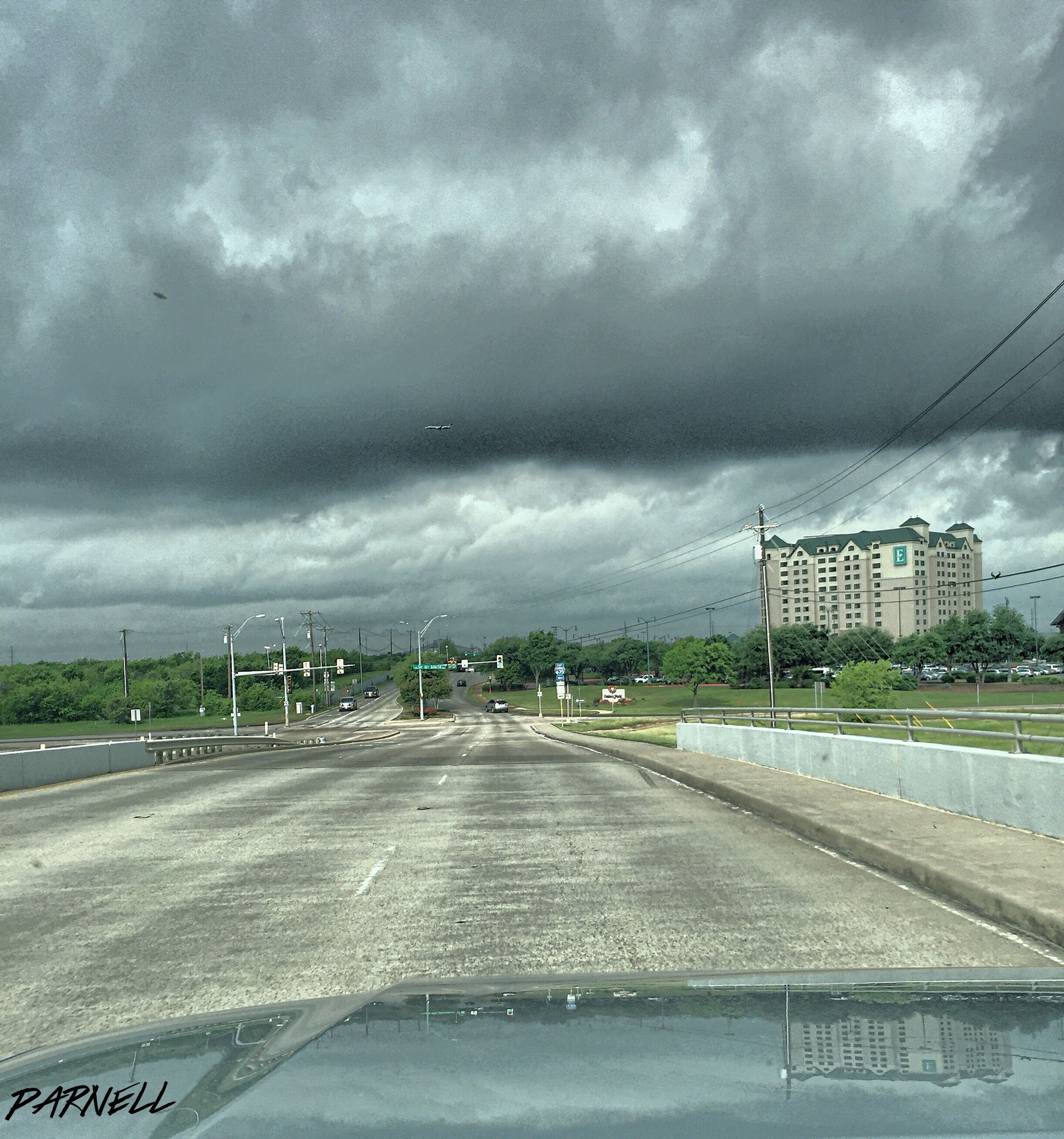 sky, cloud - sky, cloudy, transportation, road, the way forward, road marking, architecture, built structure, building exterior, weather, overcast, cloud, street, diminishing perspective, car, vanishing point, storm cloud, land vehicle, mode of transport