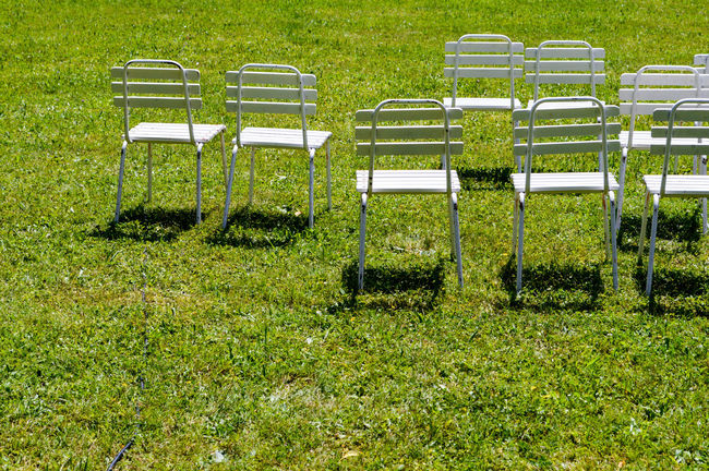 white chairs Absence Beauty In Nature Day Empty Eye4photography  Furniture Grass Grassy Green Green Color Lawn Nature No People Outdoors Park Seat Shadows Side By Side TheWeekOnEyeEM Tranquil Scene Tranquility