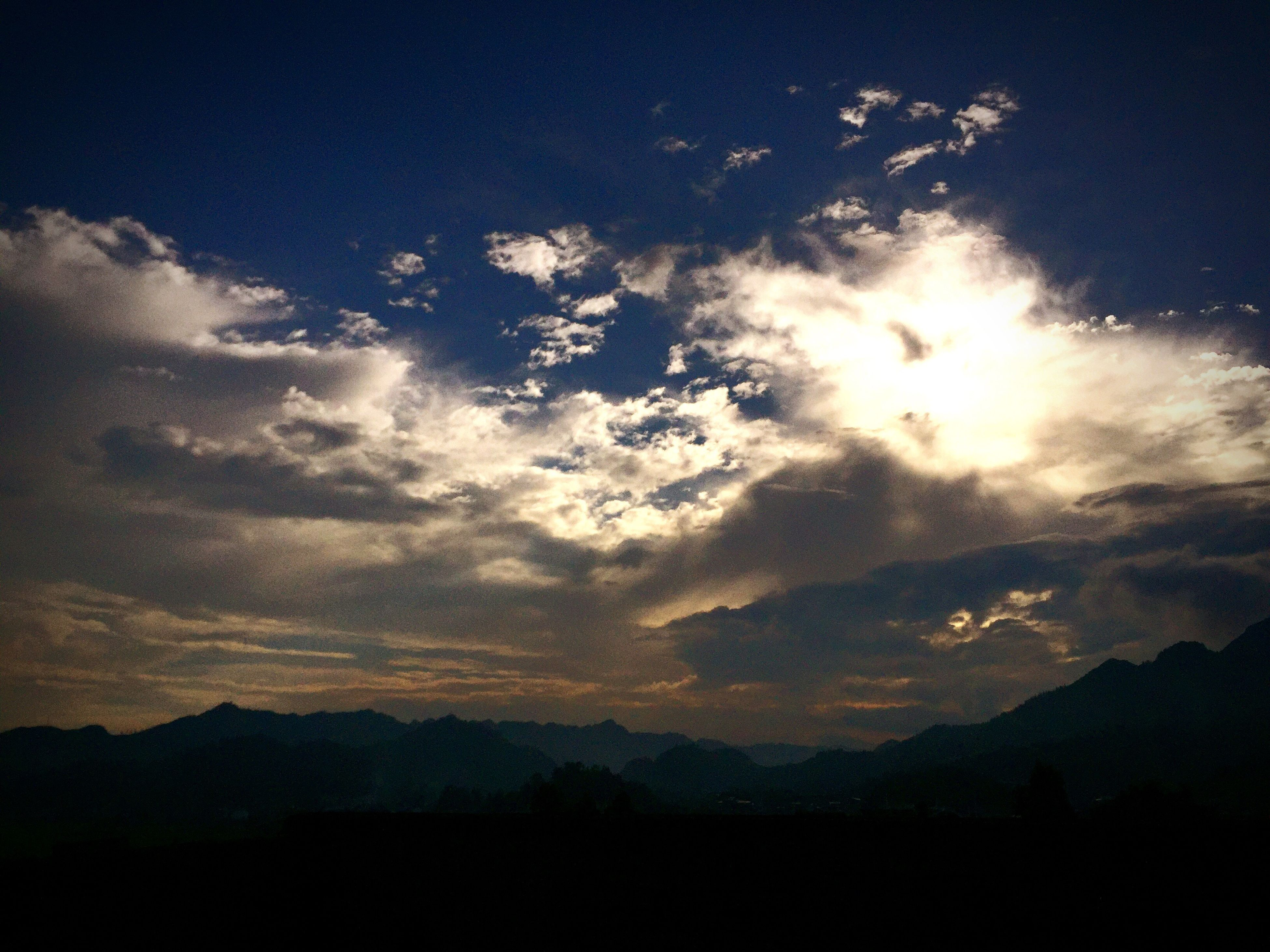 sky, cloud - sky, silhouette, sunset, sunbeam, beauty in nature, dramatic sky, no people, nature, outdoors, scenics, day, astronomy