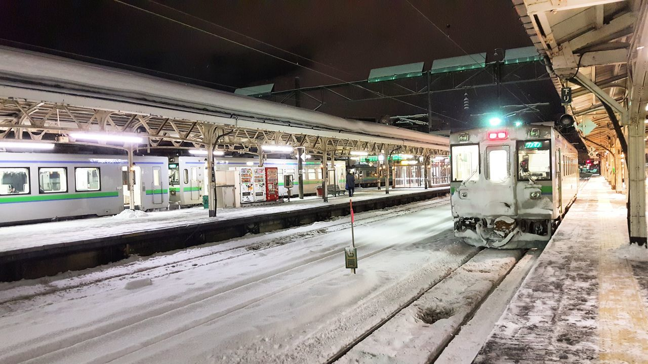 transportation, train - vehicle, mode of transport, illuminated, public transportation, rail transportation, night, railroad track, railroad station platform, real people, outdoors
