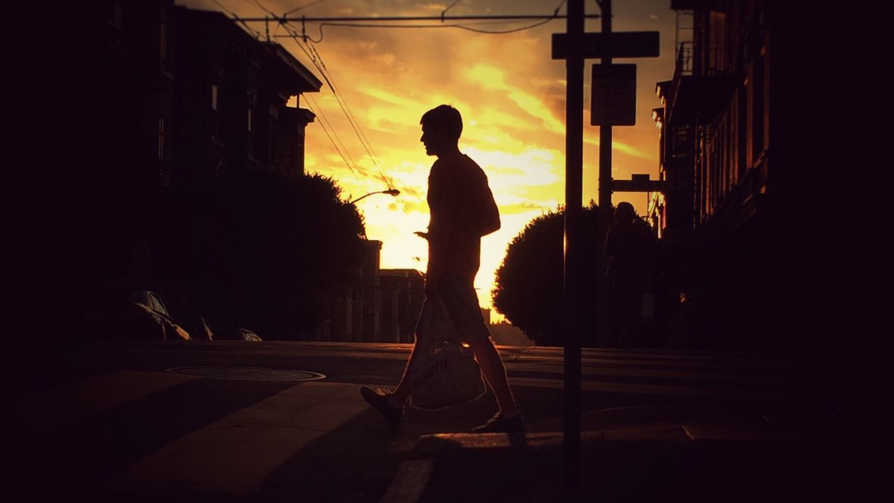 silhouette, one person, full length, sunset, real people, outdoors, men, architecture, building exterior, one man only, city, people, adult