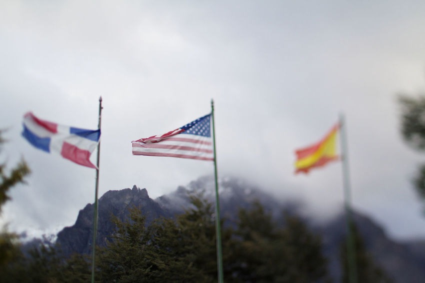 American flag in Argentina American American Flag National Patriotic Tree USA America Blowing Countryside Day Flag Flag Pole Focus On Foreground Foggy Mountains Nature No People Outdoors Patriotism Pride Sky Stars And Stripes Tiltshift Us Windy