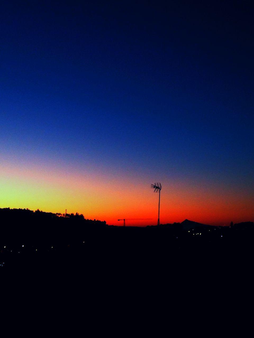 Silhouette Landscape Against Sunset Sky