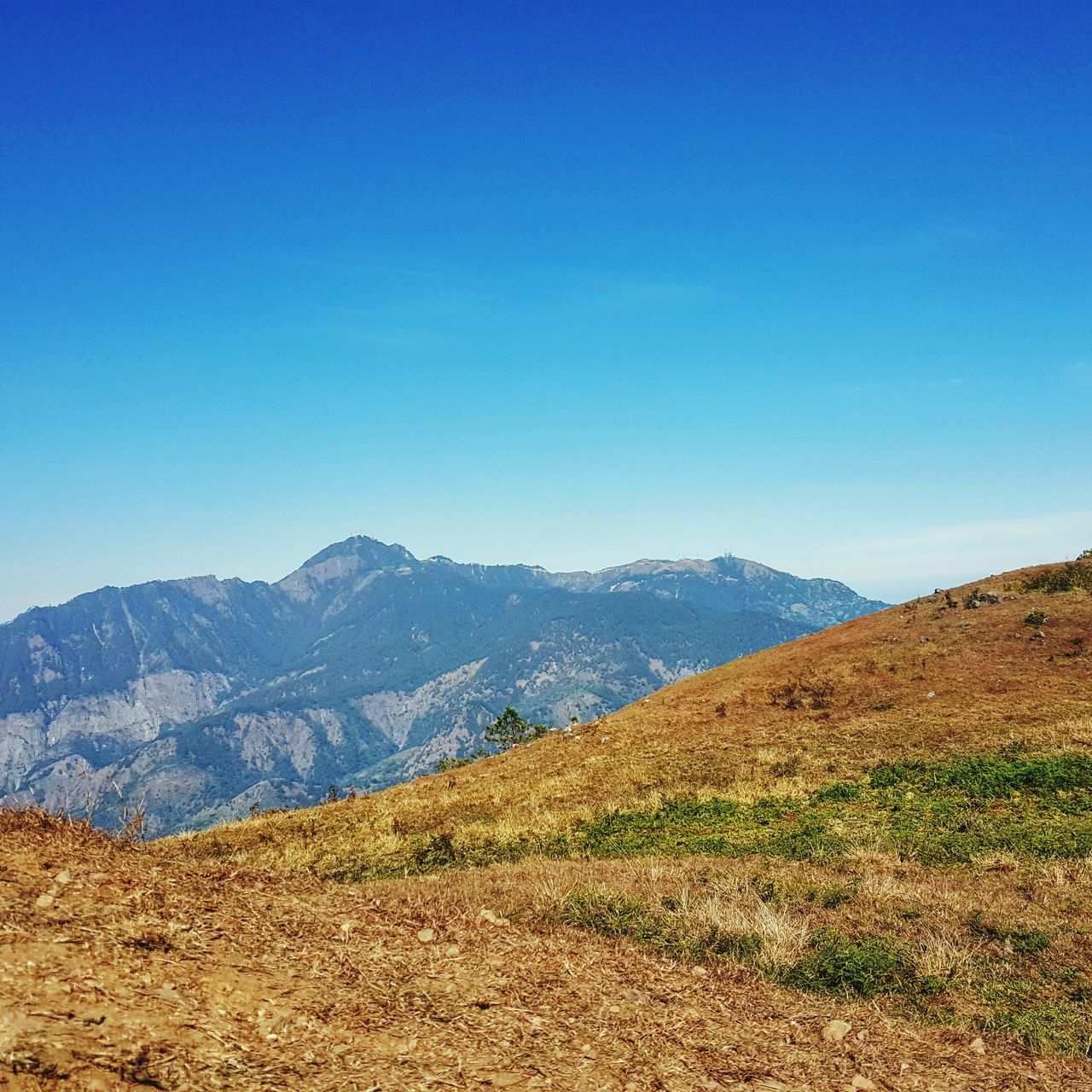 mountain, scenics, nature, tranquil scene, tranquility, beauty in nature, landscape, mountain range, blue, day, no people, outdoors, clear sky, sky