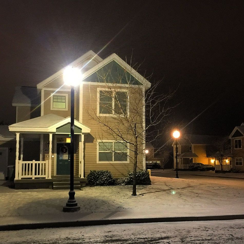A snowy night is always so peaceful. Snow ❄ Night View Peaceful Snowy Night White IPhoneography No People Freshness Beauty In Nature Outdoors Snowy Scene Snow Covered Houses Light And Shadow Single Light Source Single Light Quiet Moments Quaint  Quaint House Quaint Perspective