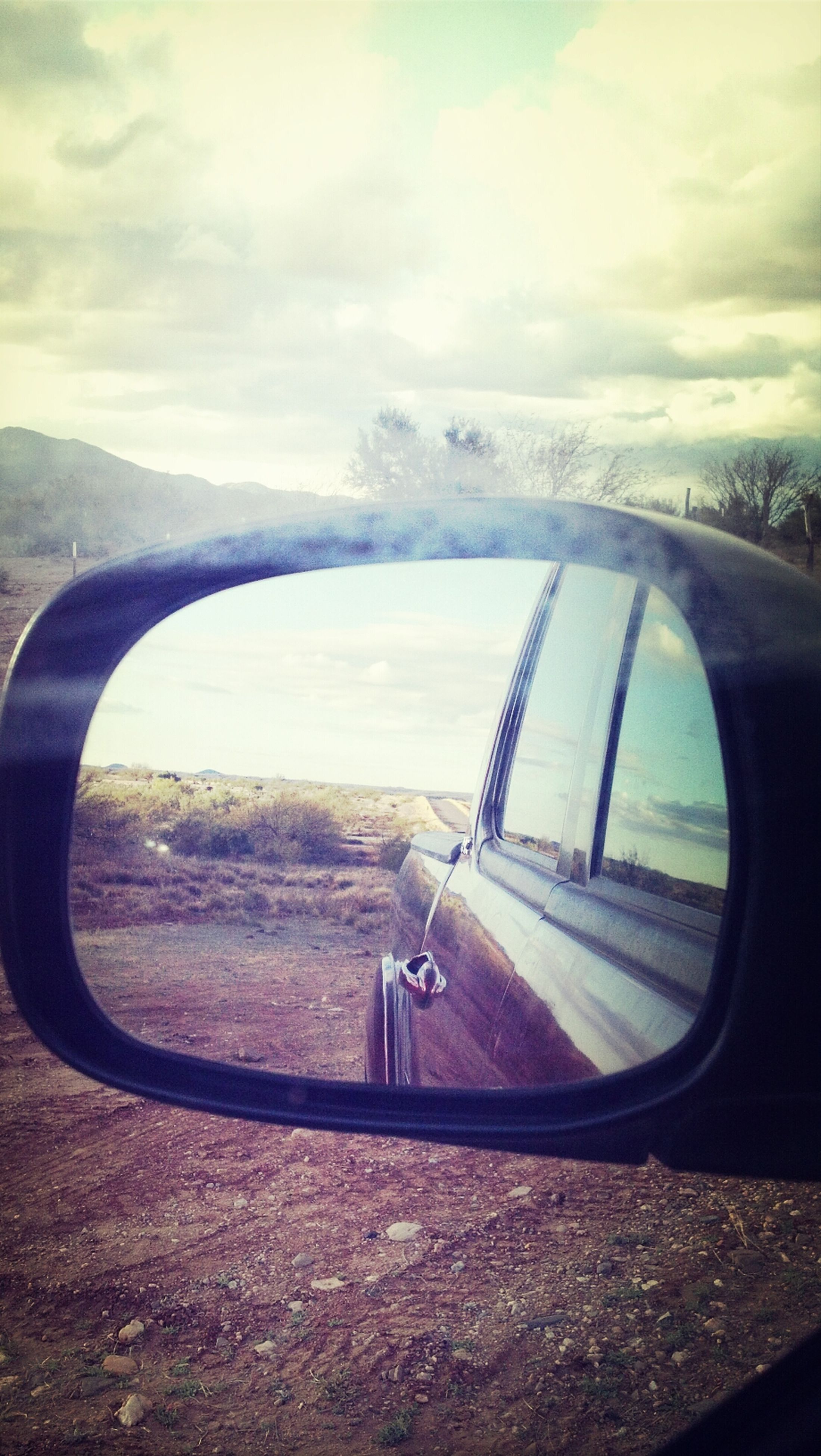 transportation, land vehicle, mode of transport, car, sky, road, side-view mirror, cloud - sky, glass - material, vehicle interior, transparent, reflection, car interior, street, windshield, travel, cloud, part of, on the move, window