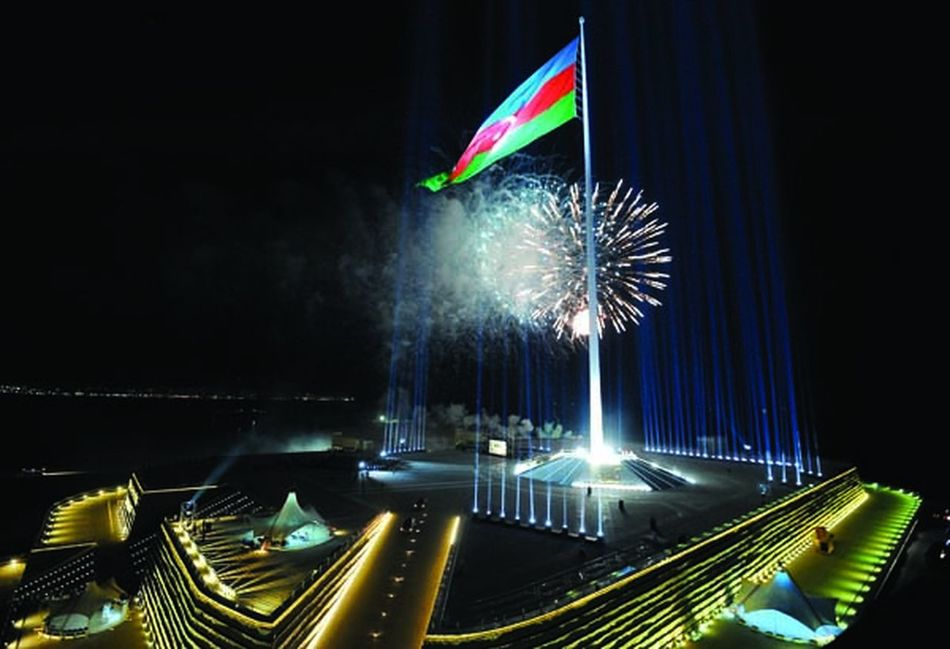 "One of the highest flag of the world is Azerbaijani flag fluttering in the square of the National Flag in Baku. Organization of the world records ""Guinness"" has affirmed in May 29, 2010 that the highest flag pillar of the world is state flag of Azerbaijan. The National Emblem of Republic of Azerbaijan, the text of the National Anthem and the Map of the country, which were installed at square, have been prepared from bronze in gilded water. Museum of the National flag has been created in the square, too. Foundation of the square of the National flag has been laid at Bayil settlement of Baku in Dec 30, 2007 near to Naval Base. ""Azenko"" company of Azerbaijan had executed the project prepared by ""Trident Support"" company of the United States of America.  The height of the constructed pillar is 162, the diameter of the foundations is 3,2, the diameter of the top of the foundation is 1,09 meters. Total weight of the device is 220 tons. The width of the flag is 35 meter, the length is 70 meters, the total area is 2450 sq.meters, and the mass is approximately is 350 kg. The weight of the flag increases twice in wet conditions. About 28 millions river rocks brought from many regions of the country were used in the construction of the wall of the pedestal of the pillar at which the tricolor flag flutters and the walls of the castle were created symbolically at surroundings of the flag. Inauguration of square of the National flag and solemn hoisting of the National flag had been implemented in September 1, 2010. 10 millions manat had been allocated to the Baku City Executive Authority from Presidential Fund included in the state budget of Republic of Azerbaijan for 2009 for purposes of construction-installation and accomplishment works in the square of National flag located in Baku city. Land Of Fire Flag Square Flag Azerbaijan Flag Relaxing Azerbaijan"