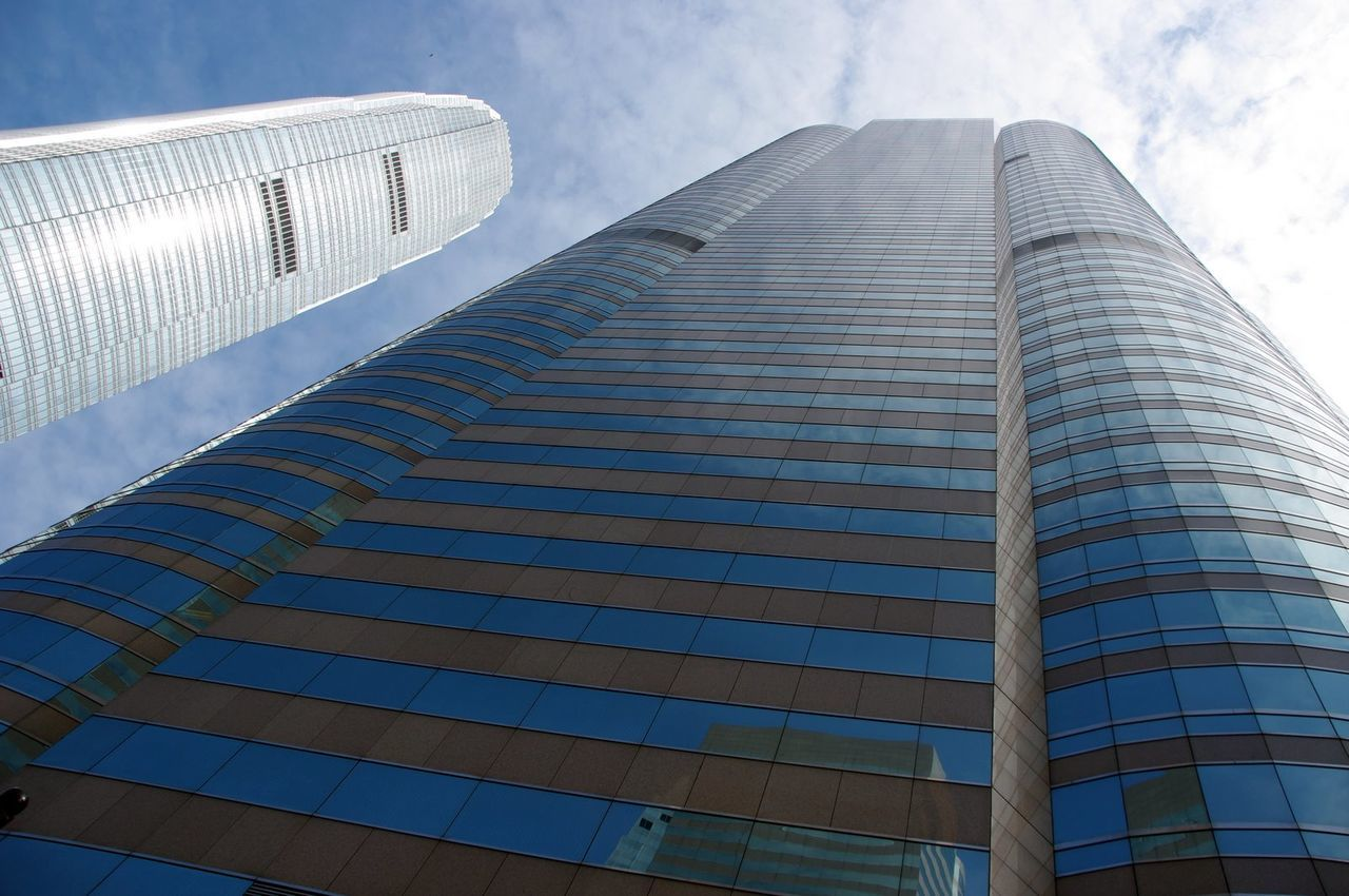architecture, low angle view, built structure, skyscraper, building exterior, sky, modern, day, city, outdoors, cloud - sky, no people, growth, tall, travel destinations