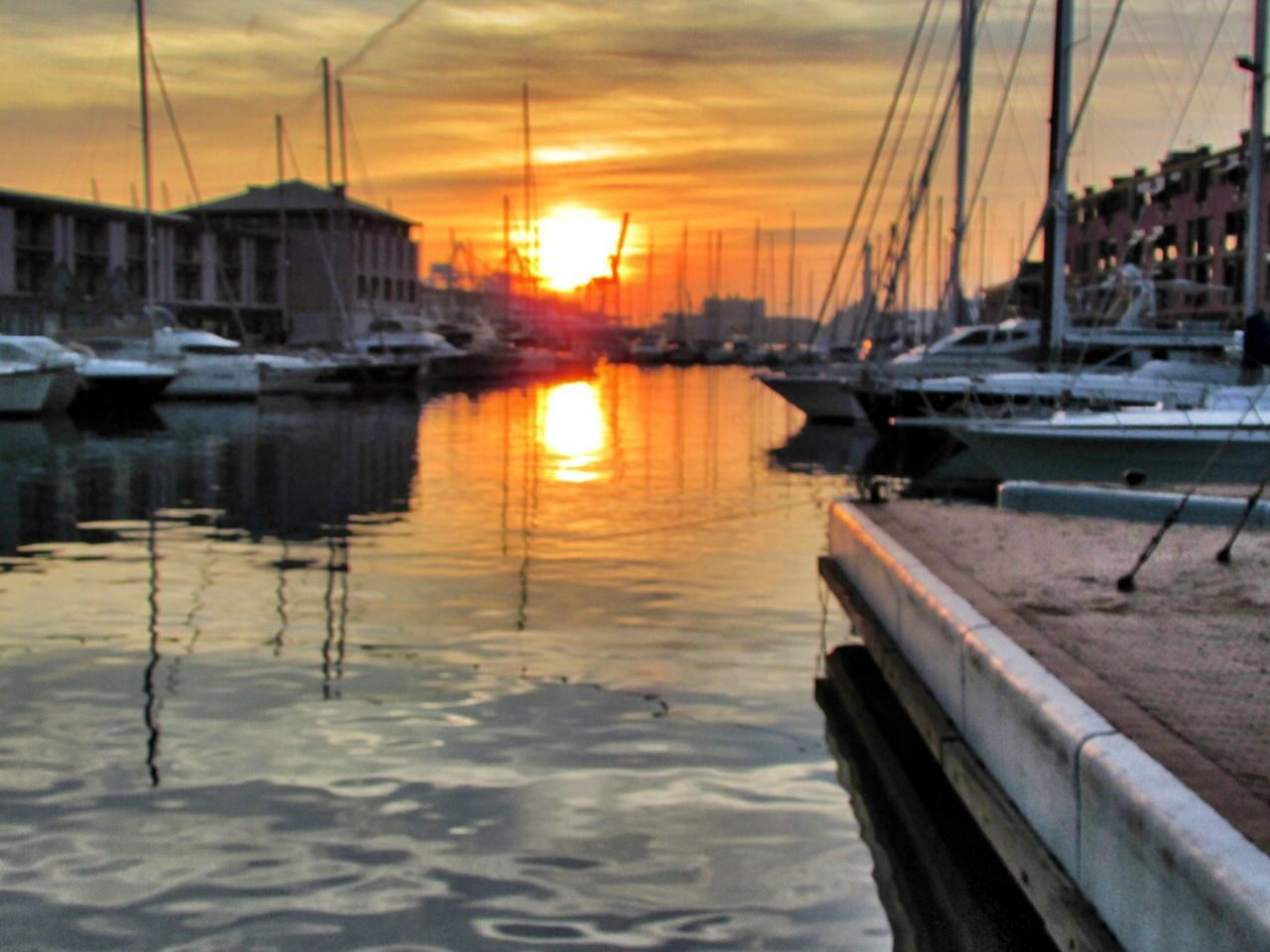 sunset, transportation, nautical vessel, water, mode of transport, boat, orange color, reflection, sky, sun, harbor, river, mast, cloud - sky, sailboat, nature, beauty in nature, outdoors, city, scenics, no people, tranquility, cloud, canal, rippled, idyllic, tranquil scene
