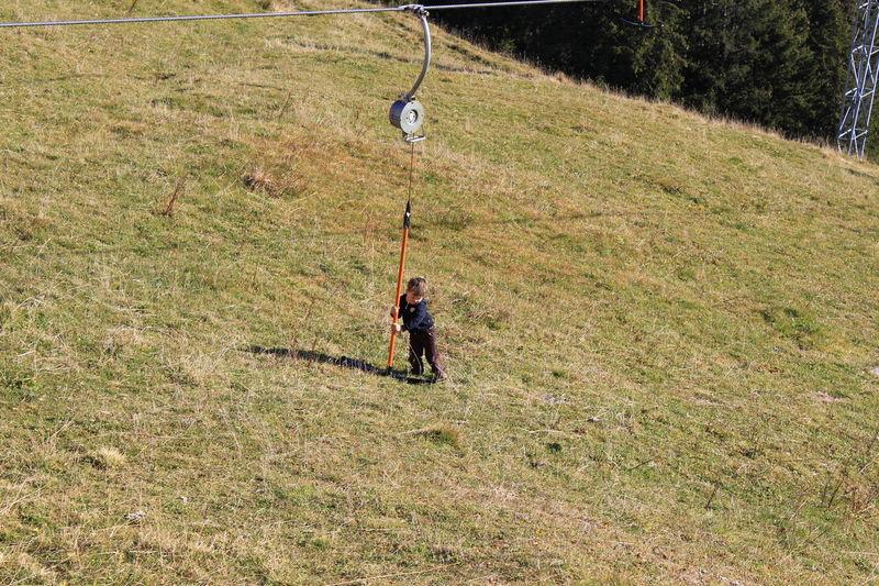 Playful boy #Switzerland #trip Boys Childhood Grass Landscape Nature Outdoors Scenics Tranquil Scene