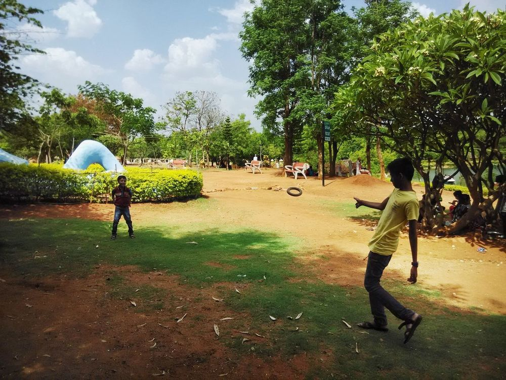 Brother Candid Photography Tree Real People Leisure Activity Park - Man Made Space Men Day Green Color Grass Playing Lifestyles Full Length Outdoors Growth People Nature Sky Togetherness Spraying Only Men Adult Candid Sunlight Beauty In Nature Let's Go. Together.