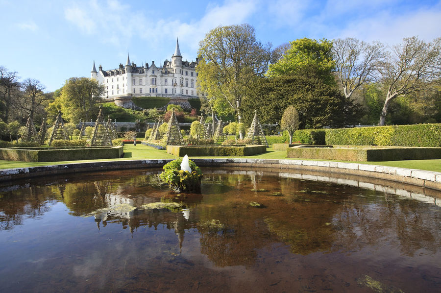 View to Dunrobin Castle from the garden. Architecture Building Exterior Built Structure Castle City Cultures Day DunrobinCastle Garden Historical Building Landscape No People Outdoors Pond Reflection Reflection Scotland Scottish Castle Scottish Highlands Sky Sutherland Travel Destinations Tree Uk Water