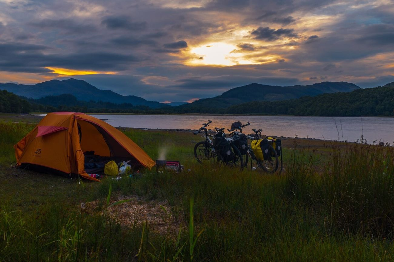 Scottish highlands are incredible, especially at bicycle pace. Sky Nature Water Beauty In Nature Mountain Sunset Cloud - Sky Scotland Scottish Highlands Bicycle Trip Bike Tour Scenics Tent Grass Landscape Lake Tranquility Mammal Outdoors No People Day Camping Outdoor Life