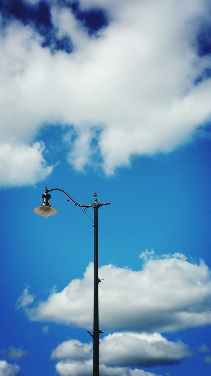cloud - sky, low angle view, sky, day, blue, outdoors, animals in the wild, technology, no people, animal themes, nature, perching