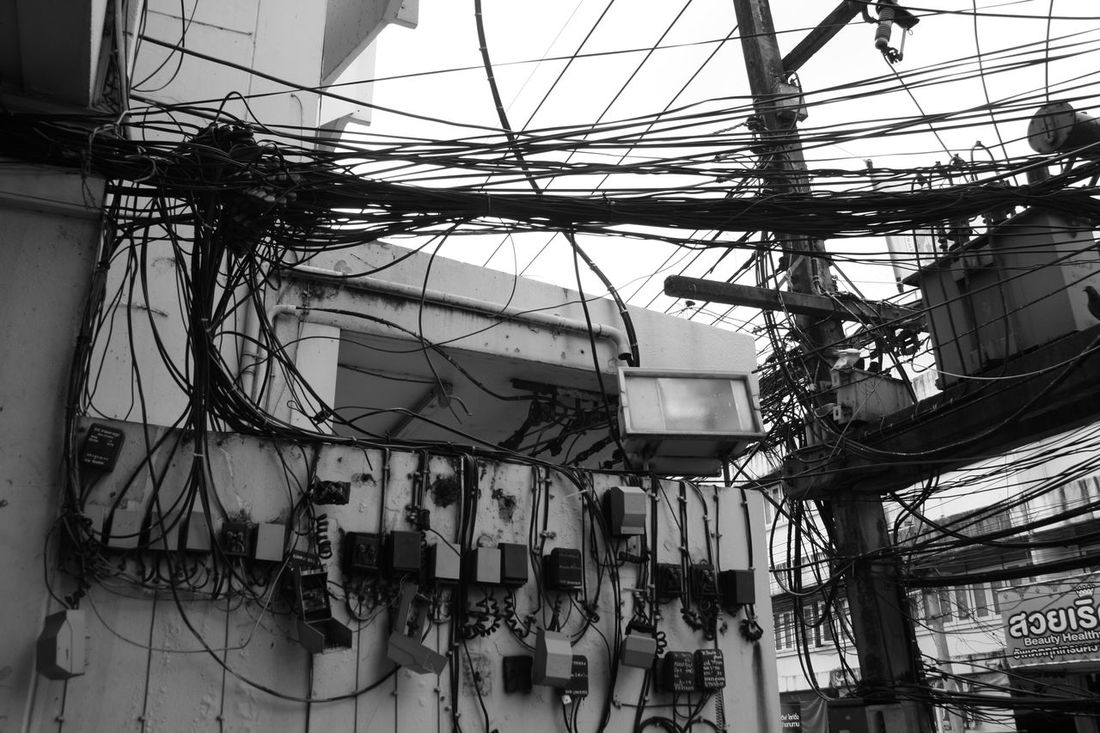 Power cables Architecture Black & White Black And White Blackandwhite Blackandwhite Photography Built Structure Cable Complexity Day EyeEm Best Edits EyeEm Best Shots EyeEm Best Shots - Black + White EyeEm Gallery EyeEm Nature Lover EyeEmBestPics Hanging Konma Low Angle View No People Outdoors Power Line  Power Supply Sky Technology Variation