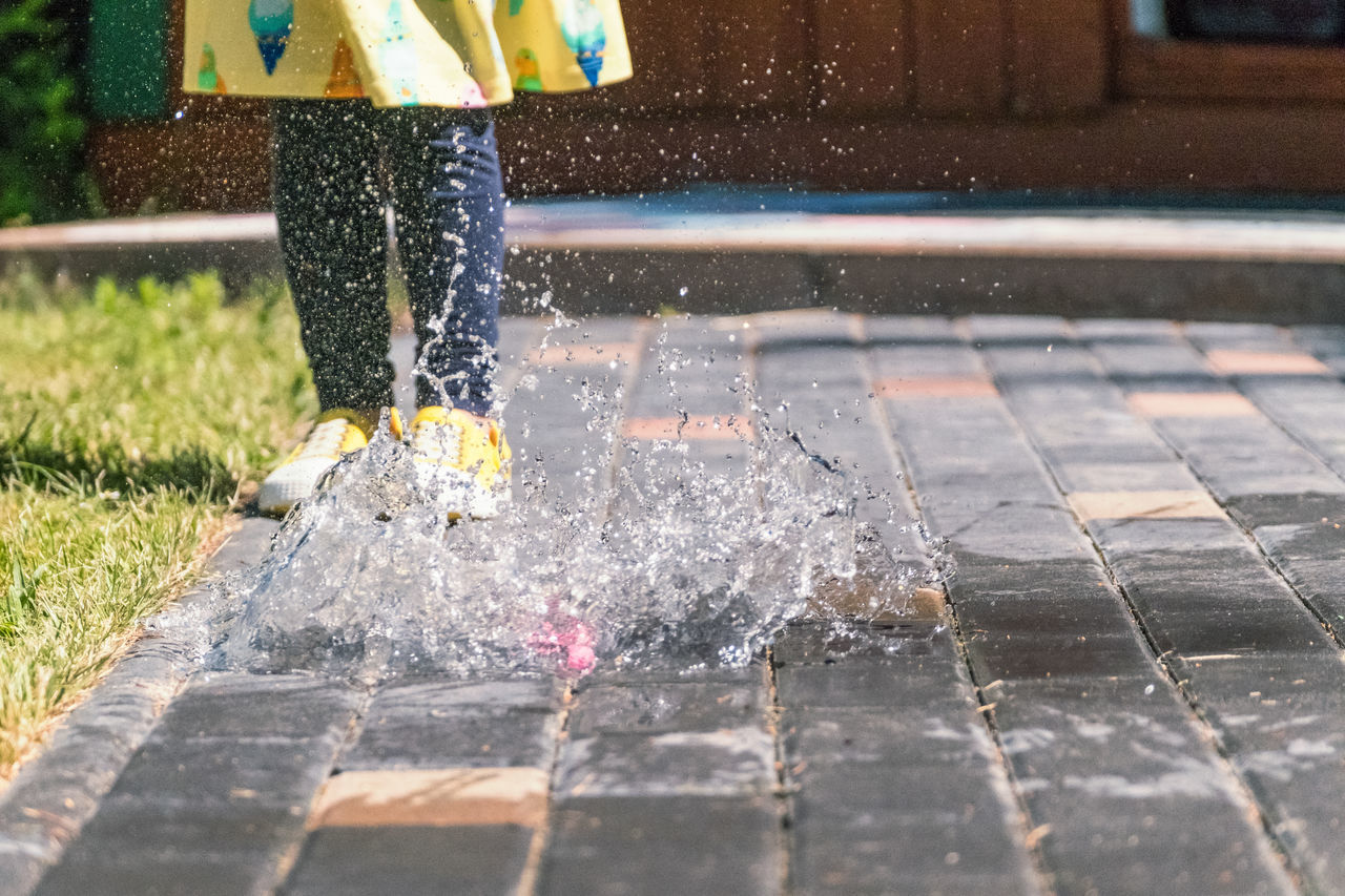 Summer Splash // Balloon Child Close-up Day Dress Flooring Fun Garden Human Body Part Human Leg Low Section Motion One Girl Only One Person Outdoors People Playful Real People Splashing Standing Stone Material Summer Throwing  Water Water Bomb
