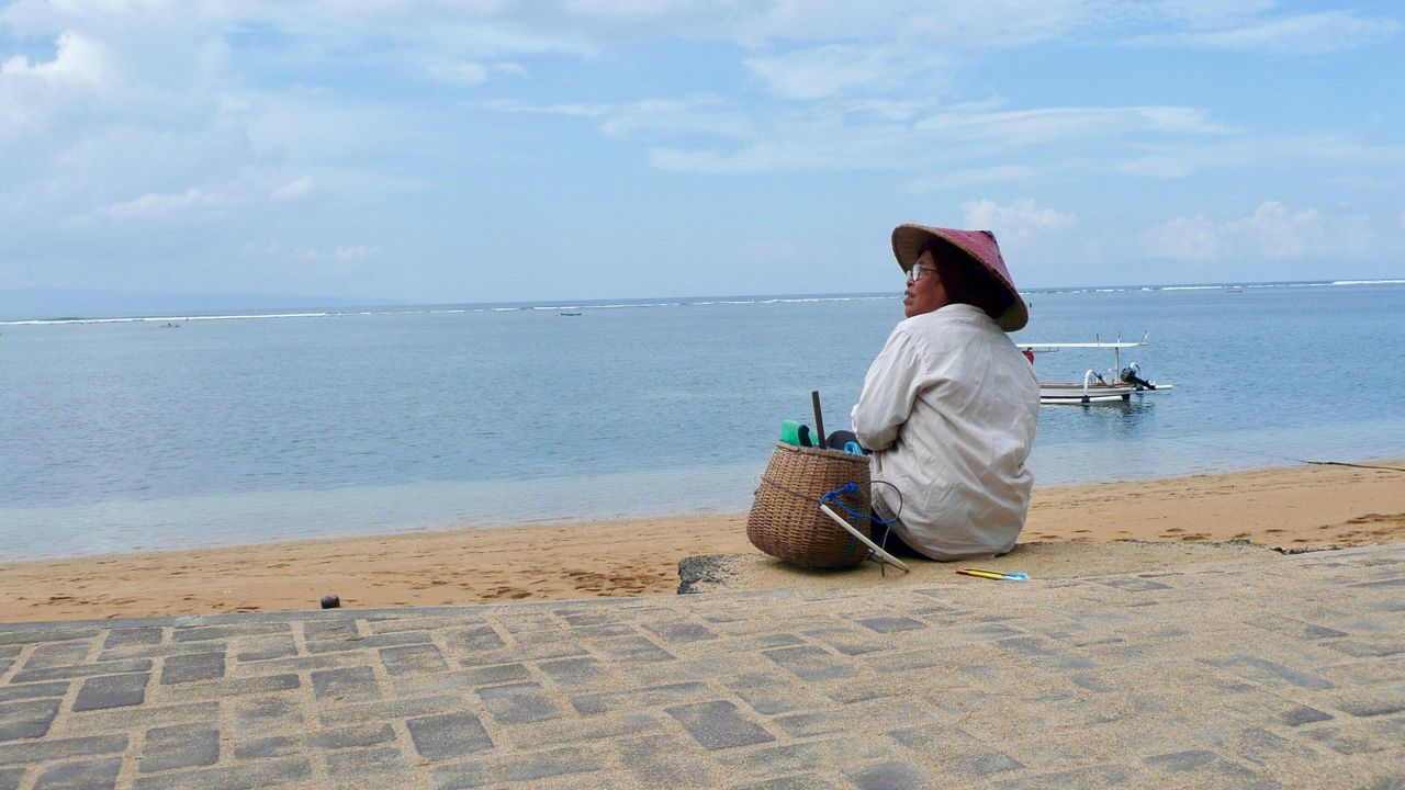 Enjoying The View Sea Water Sky Horizon Over Water Men Real People One Person Lifestyles Outdoors Beach Sitting Nature Rear View Occupation Working Day Sand Fishing Tackle Beauty In Nature Non La Leisure Activity Beach Photography