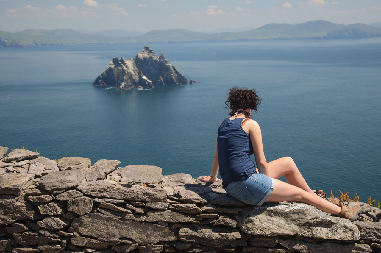 Beautiful stock photos of irland, sea, rear view, one person, sitting