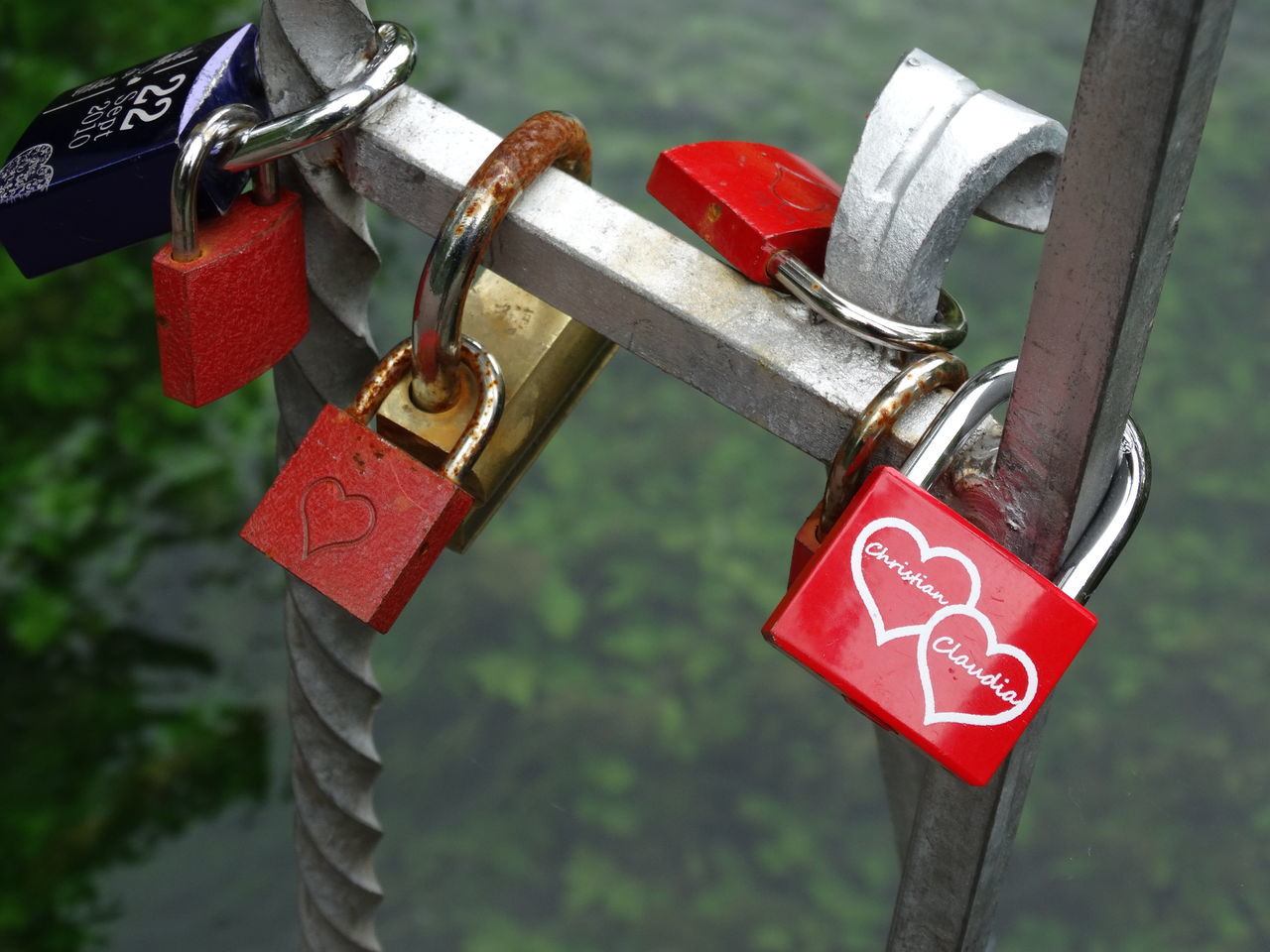 Attached Bridge - Man Made Structure Close-up Couple - Relationship Day Focus On Foreground Heart Shape Hope - Concept Lock Love Love Lock Metal Multi Colored Outdoors Padlock Protection Railing Red Romance Safe Safety Security Symbol Togetherness Trust