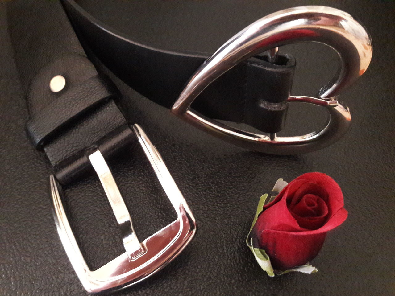 """Hold Me Tight"" Fashion Close-up Leather Belt  Man's Belt Woman's Belt Black And Red Black And Silver Conceptual Feelings Couple Tie Tight Love Tighten To Hug Relationships Close Romance Accessory Wear Two Abstract Love Welcome To Black steel Buckle EyeEmNewHere"