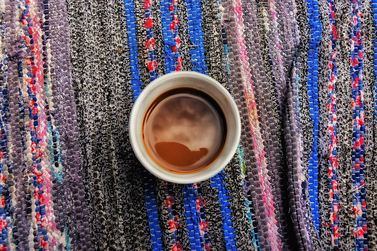 coffee cup, drink, coffee - drink, refreshment, food and drink, cup, beverage, freshness, directly above, table, no people, textile, close-up, multi colored, indoors, day, coffee bean, frothy drink