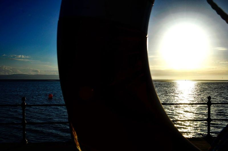 Life ring. Sea Water Nautical Vessel Sky Sun Horizon Over Water Scenics Sunlight Transportation Mode Of Transport Beauty In Nature Nature Sunset Rippled Sailing Tranquility Outdoors Day No People Close-up Lifering Seaside Beach Sea Sailing