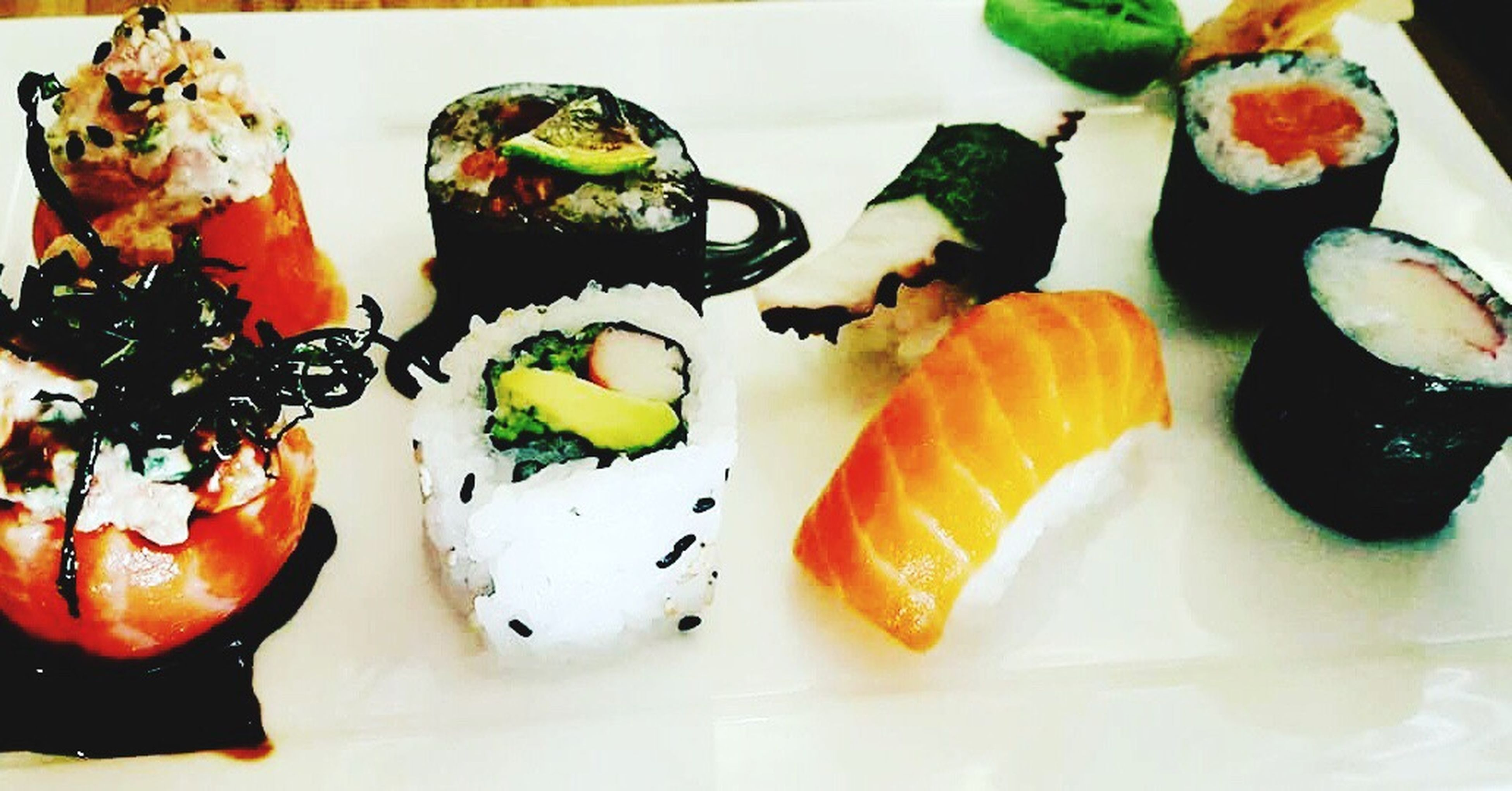 food and drink, food, indoors, freshness, sushi, close-up, healthy lifestyle, seafood, ready-to-eat, japanese food, gourmet, appetizer, salmon, healthy eating, in a row, indulgence, fish, meal, temptation, food styling, serving dish, culture, selective focus, serving size, plate, main course, lunch, food state, sashimi, dinner, arrangement