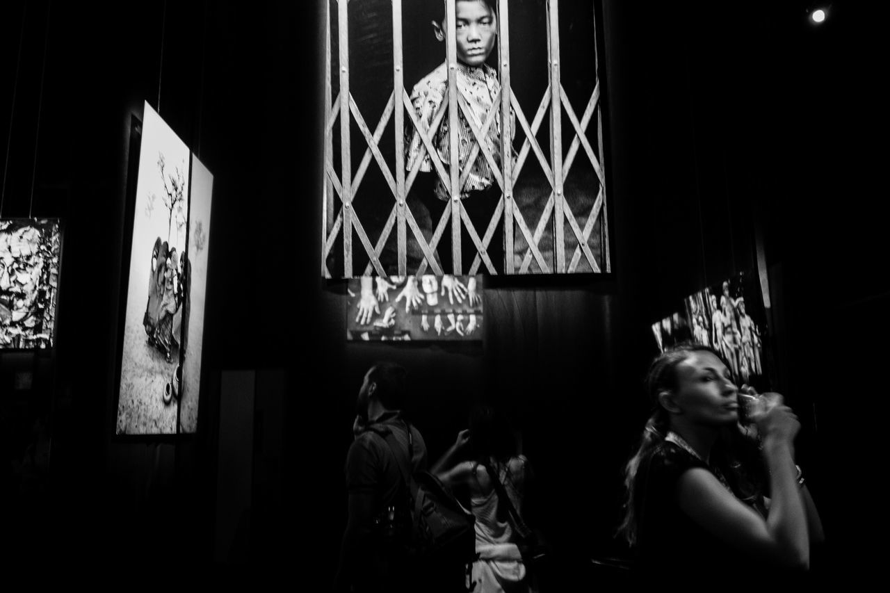 Monochrome Photography into the night, by Claudia Ioan Human Representation Indoors  Dark People Streetphotography Streetphoto_bw Fujifilm Urban Exploration Person Black And White Overnight Success City Life EyeEm Gallery Rome Embrace Urban Life