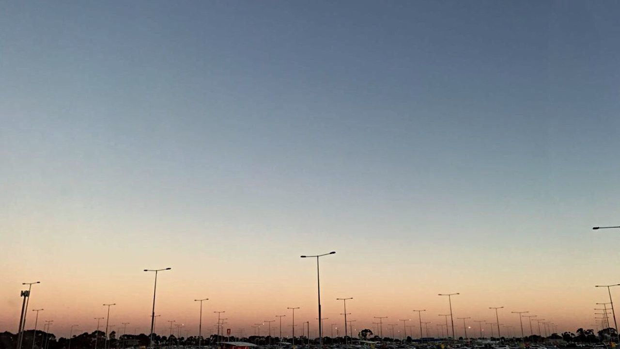 sunset, transportation, street light, flying, silhouette, outdoors, car, sky, no people, nature, scenics, beauty in nature, bird, day