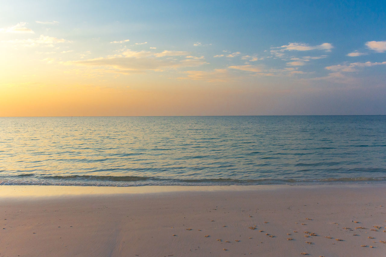 White sand beach and tropical sea at sunset. Beach Beauty In Nature Blue Calm Clouds Clouds And Sky Day Dramatic Sky Horizon Over Water Nature No People Ocean Orange Outdoors Sand Sea Still Summer Sun Sunset Tranquil Scene Tranquility Tranquility Water White Sand