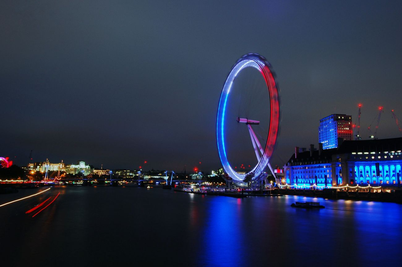 The London eye lit up in the colours of the French flag. Long Exposure Photography London Life London LondonEye View Nightphotography Night Lights French Flag Throwback Speed Night Motion Light Trail