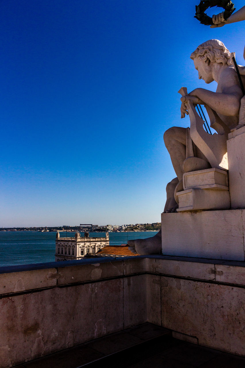 statue, sculpture, human representation, male likeness, art and craft, outdoors, built structure, no people, sky, day, clear sky, travel destinations, water, architecture